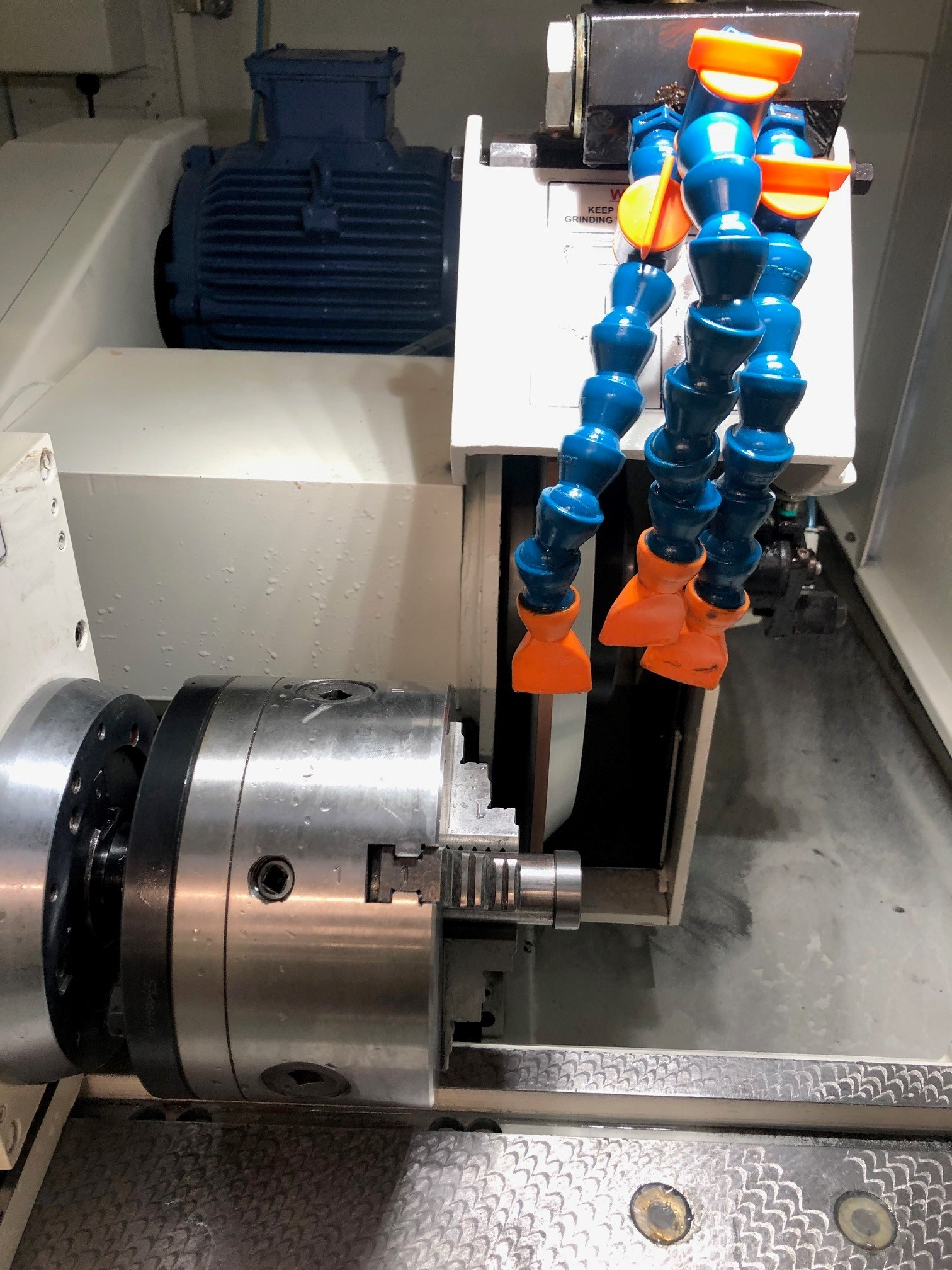 The component has a chamfer on the front corner which was ground by interpolation on their previous machine.
